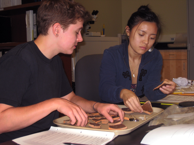Students Kyle Lee-Crossett and Stephanie Chan working with the collection.