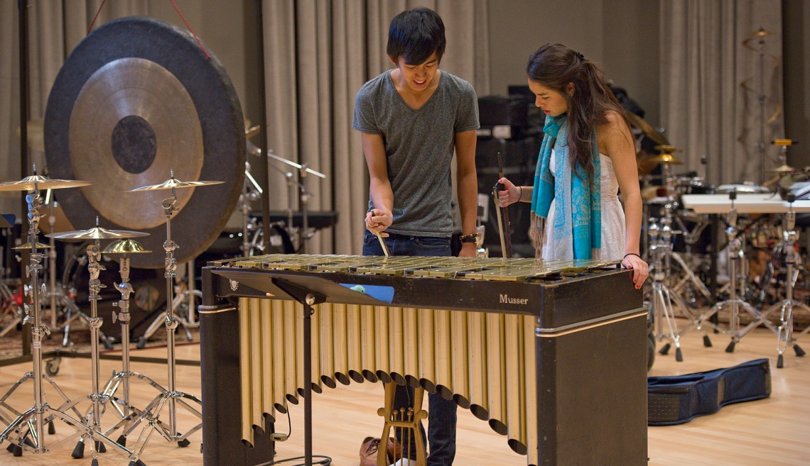 Sophomore Kenneth Qin and Junior Tina Miller experiment with the use of a violin bow on the bars of the vibraphone.