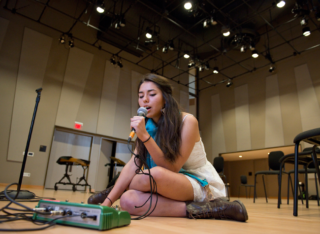 Junior Tina Miller, a singer and spoken word artist, makes a loop of her voice with the guitar pedal Kotche brought.