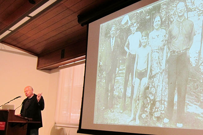 Bill Morgan, Allen Ginsberg's biographer, archivist, and friend, shared with a Stanford audience Allen Ginsberg's photos of friends and family, and told stories about Ginsberg's world travels and friendships. The photo on screen is one of Ginsberg (center) and his family.