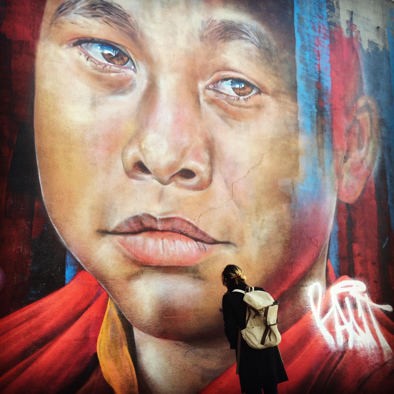 Student examines a mural in Bushwick. Credit: Sarah Curran