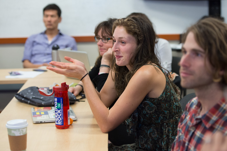 Undergraduate Maria Doerr joins in a discussion about audio production in Jake Warga's audio documentary workshop.