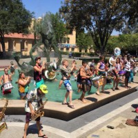 The Stanford Band performed for visitors to campus on Saturday from the White Plaza fountain and pool. Photo by Kate Chesley
