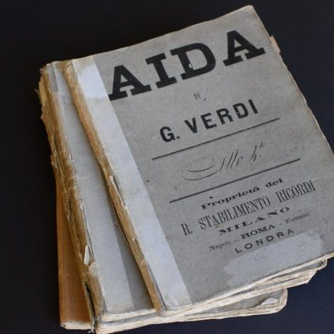 The four volumes that make up the handwritten manuscript, used in Aida's Paris premiere in 1876.